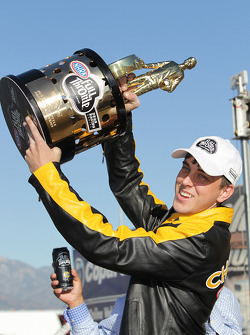 LE Tonglet raising his (wally) trophy after winning hist firs Pro Stock Motorcycle World Championship during the Auto Club NHRA Nationals