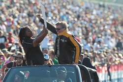 John Force celebrating with the crowd at the Auto Club NHRA Finals
