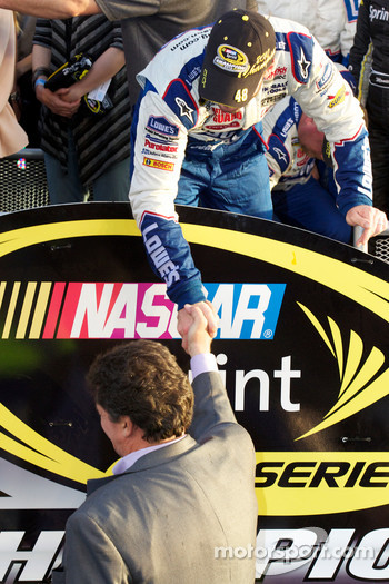 Championship victory lane: NASCAR Sprint Cup Series 2010 champion Jimmie Johnson, Hendrick Motorsports Chevrolet congratulated by NASCAR President Mike Helton