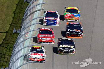 Greg Biffle, Roush Fenway Racing Ford and Ryan Newman, Stewart-Haas Racing Chevrolet lead a group of cars
