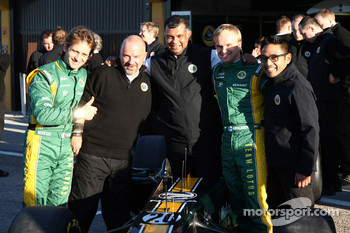 Lotus team photo, Jarno Trulli, Team Lotus, Mike Gascoyne, Team Lotus, Chief Technical Officer, Tony Fernandes, Team Lotus, Team Principal, Heikki Kovalainen, Team Lotus