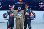 Sebastian Vettel Red Bull Racing and Mark Webber Red Bull Racing with a Haynes manual mechani