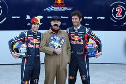 Sebastian Vettel Red Bull Racing and Mark Webber Red Bull Racing with a Haynes manual mechani