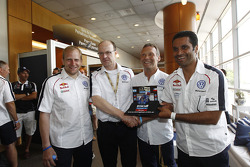 Car category winners Nasser Al Attiyah and Timo Gottschalk celebrate with Kris Nissen
