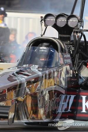 Defending champion Larry Dixon piloting his Al Annabi Top Fuel Dragster