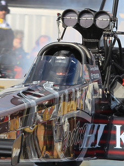 Defending champion Larry Dixon piloting his Al Annabi Top Fuel Dragster
