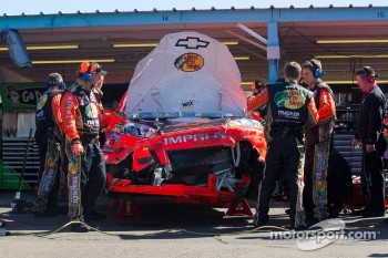 Car of Jamie McMurray, Earnhardt Ganassi Racing Chevrolet in the garage after a crash