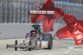 Terry McMillian deploys his parachutes aboard the Amalie Oil/Wolvering Top fuel dragster