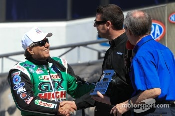 John Force being presented Racer of the Year Award by Racer Magazine Editor David Malsham