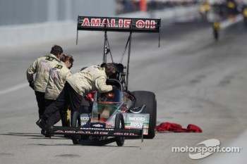 Saftey Safari attend to Terry McMillen after upsetting Larry Dixon during round one of eliminations