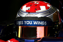 Sebastien Buemi, Scuderia Toro Rosso uses the new Bell helmet with the carbon part on top of the visor, new 2011 FIA helmet regulation
