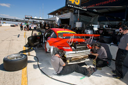 Flying Lizard Motorsports team member at work