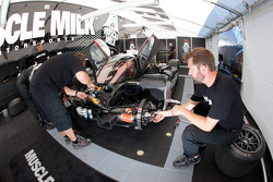 Muscle Milk Aston Martin Racing team members at work