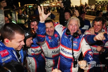 Oreca team manager Hugues de Chaunac celebrates with his team