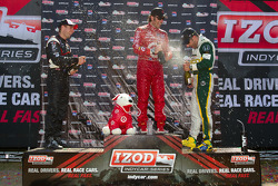 Podium: race winner Dario Franchitti, Target Chip Ganassi Racing, second place Will Power, Team Penske, third place Tony Kanaan, KV Racing Technology-Lotus celebrate with champagne