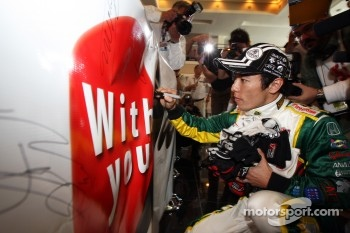 Takuma Sato, KV Racing Technology-Lotus with the banner to support Japan