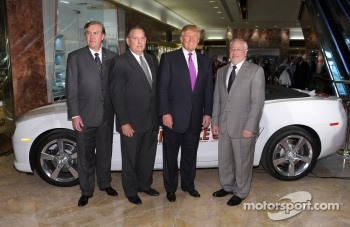 Donald Trump (2nd R) accepts the keys to the Indianapolis 500 Chevrolet Camaro SS Convertible Pace Car from Allen Sirkin, President and Chief Operating Officer, Phillips-Van Heusen (L) ,Jeff Belskus, CEO, Indianapolis Motor Speedway (2n L) and Jeff Chew,