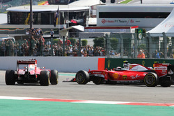 Sebastian Vettel, Ferrari SF16-H spins alongside team mate Kimi Raikkonen, Ferrari SF16-H at the start of the race