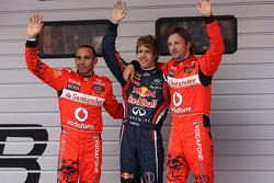 Pole winner Sebastian Vettel, Red Bull Racing, second place Jenson Button, McLaren Mercedes, third place Lewis Hamilton, McLaren Mercedes