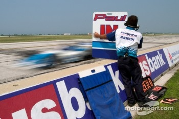Paul Tracy flies by his pitboard