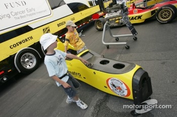 Young fans check out a Champ Car chassis