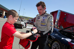 Race winner #55 Boardwalk Ferrari/Level 5 Ferrari 458 Challenge: Scott Tucker sign an autograph