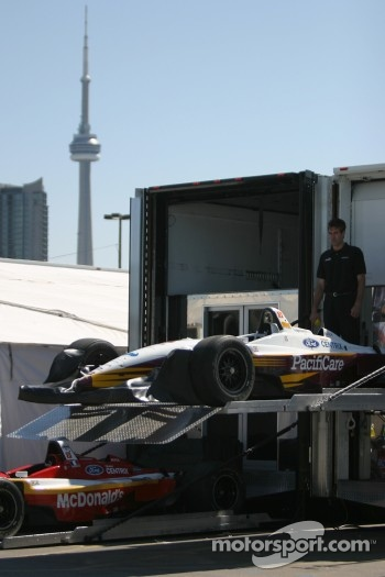 Newman Haas Racing crew member unload the cars