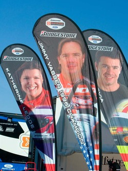 Banners for PKV drivers Katherine Legge, Jimmy Vasser and Oriol Servia