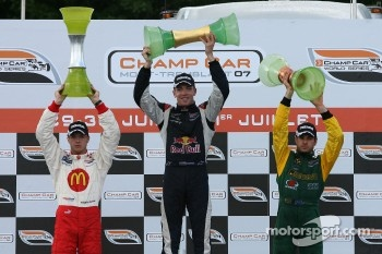 Podium: race winner Robert Doornbos celebrates with Sbastien Bourdais and Will Power