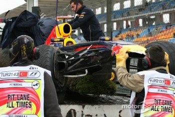 Sebastian Vettel, Red Bull Racing after he crashed on FP1