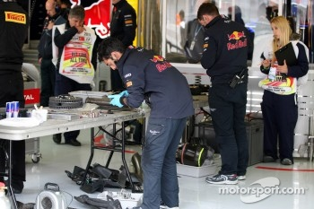 Mechanics work on the car of Sebastian Vettel, Red Bull Racing, RB7