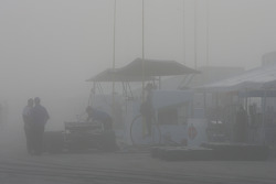 A foggy paddock at the start of the session