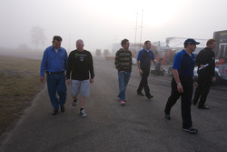 Franck Montagny, Paul Tracy and Forsythe Pettit Racing team members walk the pit lane