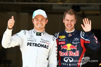 Pole winner Sebastian Vettel, Red Bull Racing, third place Nico Rosberg, Mercedes GP F1 Team