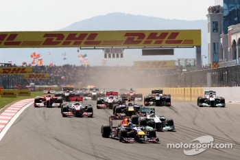 Sebastian Vettel, Red Bull Racing leads Nico Rosberg, Mercedes GP F1 Team, MGP W02 at the start of the race