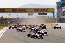 Sebastian Vettel, Red Bull Racing leads Nico Rosberg, Mercedes GP F1 Team, MGP W02 at the start of the race