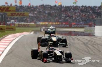 Vitaly Petrov, Lotus Renault GP, R31 leads Jarno Trulli, Team Lotus, TL11
