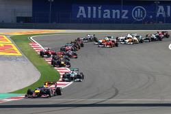 Sebastian Vettel, Red Bull Racing leads at the start