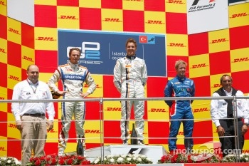 Stefano Coletti celebrates his victory on the podium with Giedo Van der Garde and Sam Bird