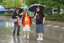 Fans under the rain