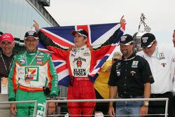 Race winner Dan Wheldon celebrates with Kim Green and Michael Andretti