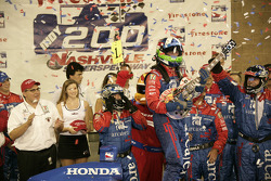Victory lane: race winner Dario Franchitti celebrates