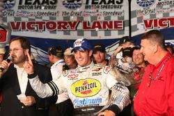 Victory lane: race winner Tomas Scheckter celebrates
