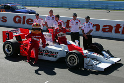 Pole winner Helio Castroneves celebrates
