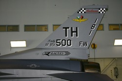 P.J. Chesson rides with the Indiana National Guard: the tail of an F-16 Fighting Falcon