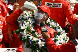Race winner Sam Hornish Jr.drinks the traditional Indy 500 winners' milk