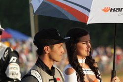 Toshiki Yoshioka with his Hankook Tire umbrella girl