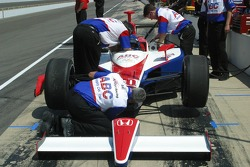 A crew member for Al Unser Jr. prepares the car