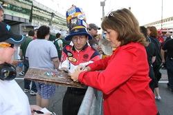 Lyn St. James signs autographs