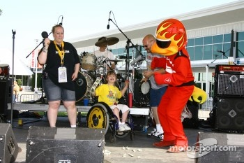 Firestone Firehawk dances on stage during Mother's Day at the track